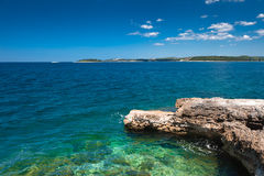 Adriatic sea scenic view. Croatian coast. Adriatic sea scenic view. Focus on stones on foreground. Croatian coast in touristic season Stock Photography