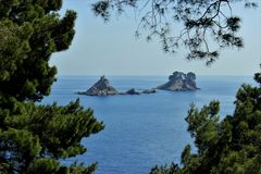 Adriatic Sea small islands, pine-trees silhouette, clean sky landscape of the Mediterranean Region, Montenegro. Adriatic Sea, small island Katic view, pine-trees Stock Photo