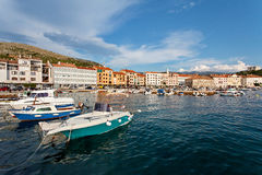 Adriatic sea at sunset, fishing boats in the harbor in Senj, Croatia Royalty Free Stock Images