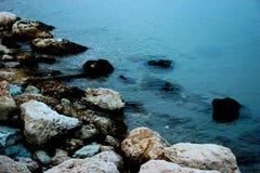 Adriatic sea washing a shore full of stones royalty free stock photos