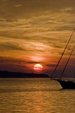 Adriatic Sunset and A Boat Royalty Free Stock Photos