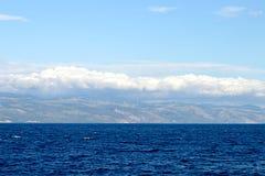 Adriatisches Meer und Wolken oben Stockbilder