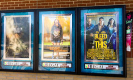 Ads for movies at Regal Cinema in Summerville, SC. Ads for movies at Regal Azalea Square Stadium in Summerville, SC Royalty Free Stock Image