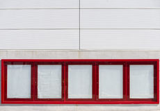 Ads publicity empty. Red empty advertising ads on the front of shopping center stock photo