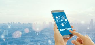 Ads on the screen of a smartphone royalty free stock images