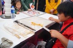 Aduanas populares chinas: pintura del jarabe Fotos de archivo