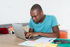 Adult african american man with concentration at work with compu Stock Photo