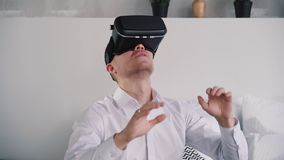 Adult american man uses excitement network device of augmented reality. Cyber innovation for happy gamer, corporate game score and technology connection stock video