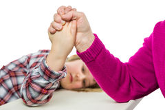 Adult arm wrestling with young dutch girl Stock Image