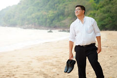 Adult Asian Fat man in white shirt and Carry shoes feeling despondent from  hard work be finding relaxing and meditation by walkin Royalty Free Stock Images