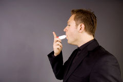 Adult with Asthma inhaler Royalty Free Stock Images