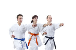 Adult athletes in karategi are beating punch arm Royalty Free Stock Photos