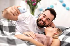 Adult attractive couple in bed Royalty Free Stock Photography