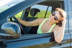 Adult attractive happy woman sitting in car. Summer portrait outdoor Stock Photography
