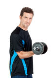 Adult attractive man with iron dumbbell isolated Stock Photography