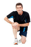 Adult attractive man in sportswear knee pain injury ache isolated Royalty Free Stock Photo