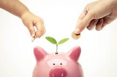 Adult and baby doing green saving Stock Photos