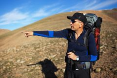 Adult backpacker in mountains Stock Photos