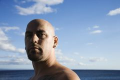 Adult bald male on beach. Stock Photo