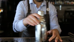 Adult bartender trains to do the trick in the bar stock video
