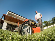Adult bearded male with lawnmower Royalty Free Stock Photos