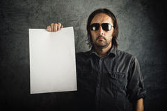 Adult bearded man holding blank paper Stock Photography