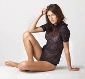Adult beautiful sensual brunette sitting Stock Image