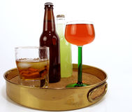 Adult Beverages. Brass serving tray with assorted adult beverages Royalty Free Stock Photo