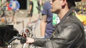 Adult biker in sunglasses, leather jacket, nautical hat ride on painted motorcycle. Summer sunny day. Funny pictures stock video