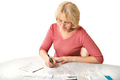 Adult blond woman with document Royalty Free Stock Photography