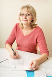 Adult blond woman with document Stock Photography
