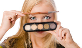 Adult blonde with makeup brushes Stock Photo