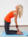 Adult blonde woman doing backward bend Stock Photography