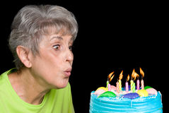 Adult blowing out candles Royalty Free Stock Images