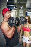 Adult bodybuilder swings biceps in the gym.  Stock Photography