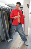 Adult boy in shop Royalty Free Stock Photo