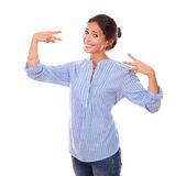 Adult brunette on blue blouse with victory sign Royalty Free Stock Photos