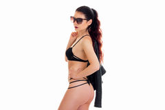 Adult brunette woman in black lingerie and sunglasses Royalty Free Stock Photography