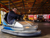 Adult on Bumper Cars Stock Photo