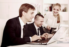 Adult business male sitting with coworkers stock photos