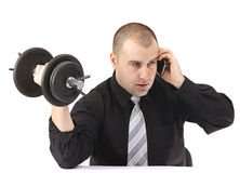 Adult business man doing fitness at work Royalty Free Stock Images