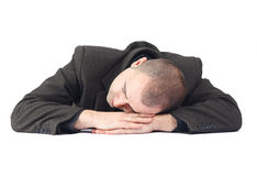 Adult business man sleeping at work Royalty Free Stock Image
