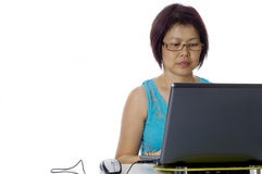 Adult business woman working at her computer Royalty Free Stock Photo