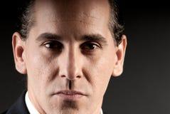 Adult businessman closeup portrait on dark stock photos