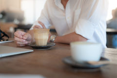 Adult businessman drinking coffee in cafe Stock Photo