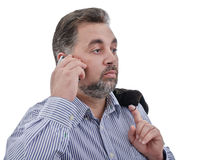 Adult businessman listening at mobile phone Royalty Free Stock Image