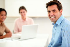 Adult businessman looking and smiling at you Stock Images