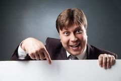 Adult businessman pointing at blank space Royalty Free Stock Image