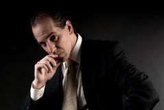 Adult businessman serious thinking sitting Stock Image