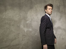 Adult businessman wearing the black suit Stock Photo